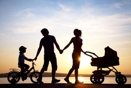 Happy family walking hand in hand